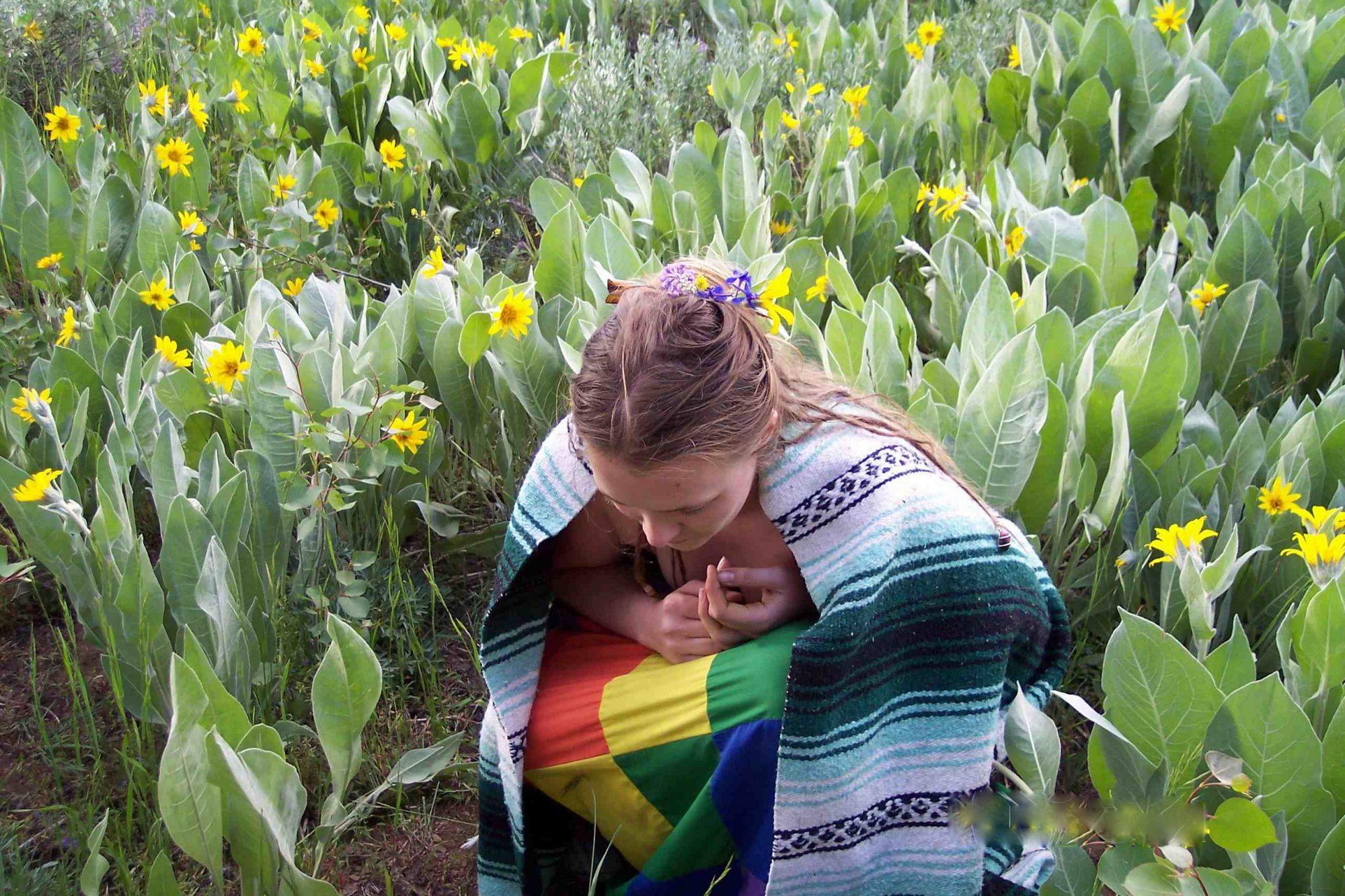 A faery woman praying in the daffodils.